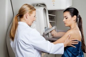 doctor gives woman a mammogram